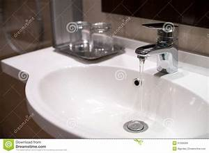 water running in sink from tap stock image image 31326269 With is bathroom tap water drinking water