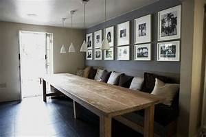 love the long dining table and cozy sofa noticed a stack With dining room table with bench against wall