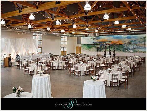beautiful wedding at yeg blatchford air hangar wedding designed by mcanally from