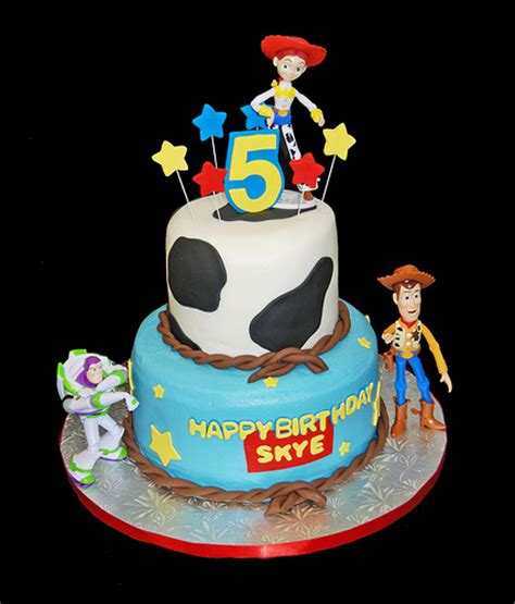 story birthday cake 5th birthday cow print and 2 tiered cake with st