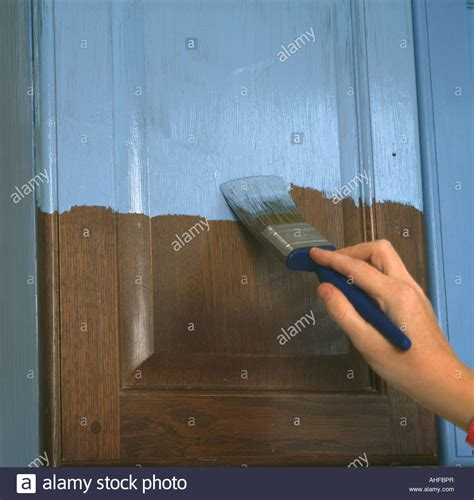 How To Paint Cupboard Doors by Up Of Painting Cupboard Door With Blue Paint