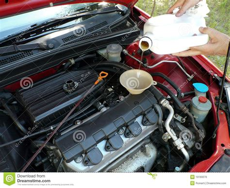 Adding Motor Oil To Car Royalty Free Stock Image