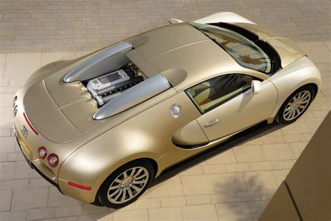 Improbable as it may sound bugatti has somehow upstaged the already limited run bugatti veyron super sport with a special edition version of. Gold Bugatti Veyron Photo 11 5637