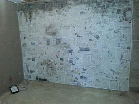 paper mache wall newspaper basement cinder block walls