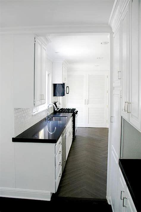 white kitchen cabinets  black  gold hardware transitional kitchen