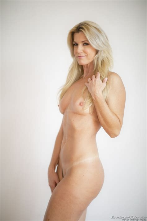 Blonde Milf With Small Chest Poses Naked At Every