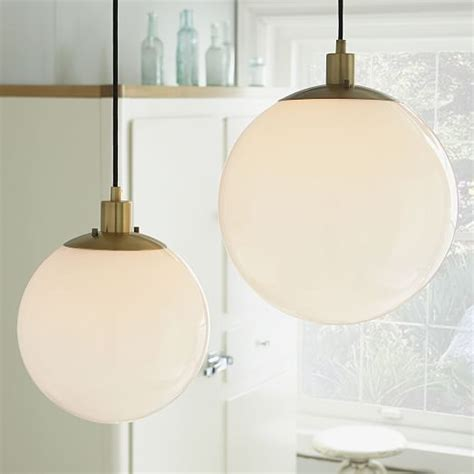 globe pendant antique brass milk finish west elm