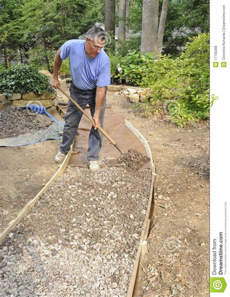 building a gravel path man building gravel path royalty free stock photos image 17735268