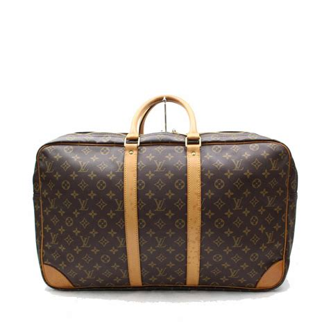 louis vuitton sirius   brown monogram travel bag  modsie