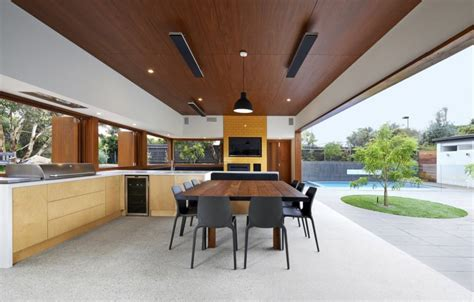 summer house expansion creates courtyard modern