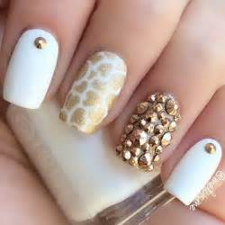 Amazing looking white and gold nail art design the nails are painted
