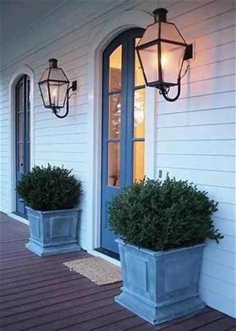 front entrance outdoor lighting charming entry way with planters and lanterns bevolo