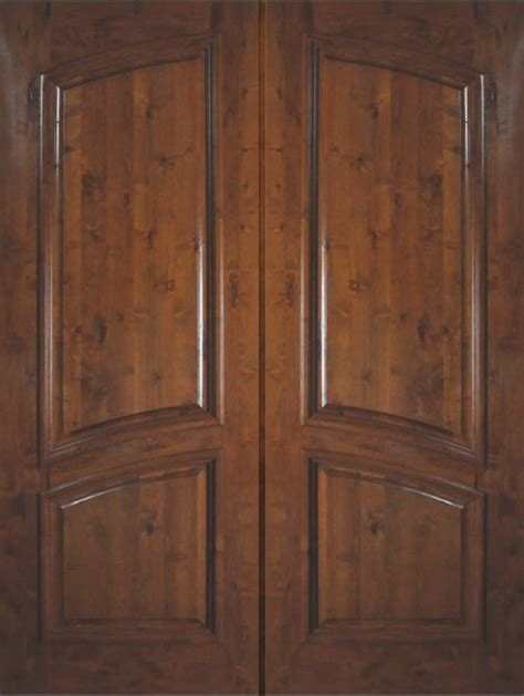slab entry double door  wood knotty alder  panel solid