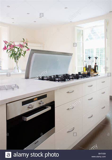 fitted oven  white island unit  worktop mounted