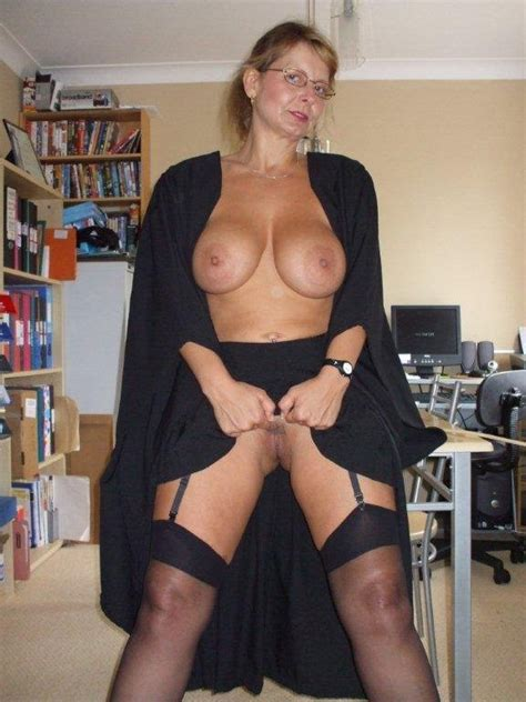 British busty MILF Sally dressed as a school mistress