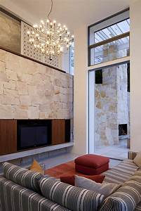 Wand Mit Steinen : steinwand wohnzimmer 43 beispiele wie steine auf das ~ Michelbontemps.com Haus und Dekorationen