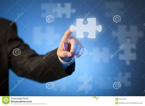 Businessman's Hand Touching Abstract Puzzle Piece Stock