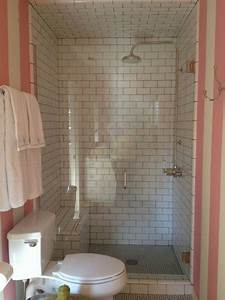 sweet and simple bathroom with white subway and hex tile With pink and cream bathroom