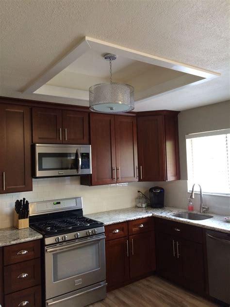 Fluorescent kitchen light box makeover.   Building a nest
