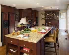 kitchen island granite santa cecilia light granite kitchen traditional with gray glass front cabinets