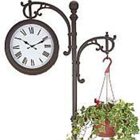 freestanding two sided clock with plant hanger outdoor