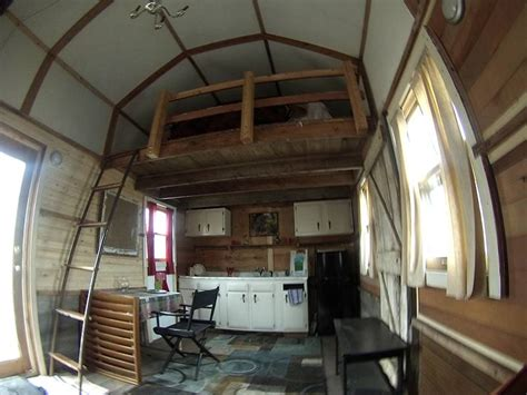 storage shed converted to house college students convert grain shed into cozy cabin