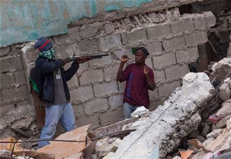 Gang Members In Haitian Slum Profit From Disaster
