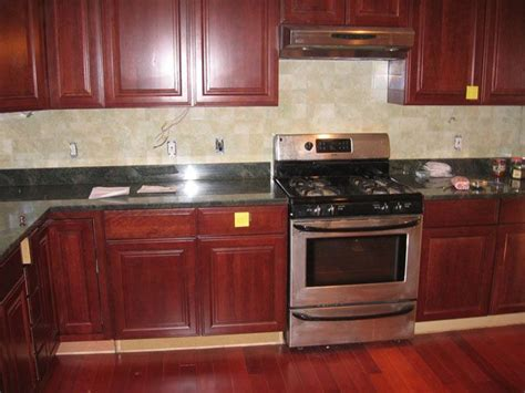 kitchen backsplash ideas with cherry cabinets legacy cherry cabinets with granite and ceramic tile 9057