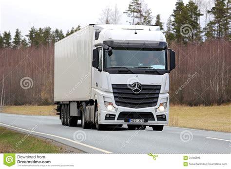 mercedes truck white white mercedes benz actros semi truck on spring road