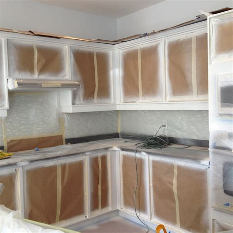 spray paint kitchen cabinets cost spray painting kitchen base cabinets kick plates crowns