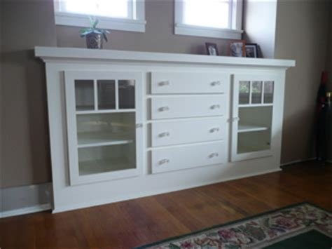 Custom dining room sideboard TV cabinet above fireplace mantel