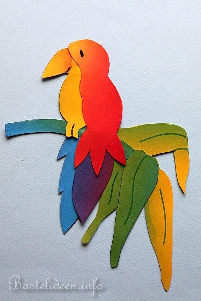 tiere basteln aus papier papagei fensterbild