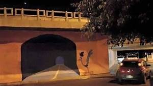 artist painted a road runner tunnel on a wall