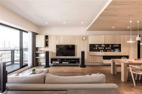 A Modern Apartment Celebrates The Look Of Natural Wood :  Light Wood Paneling Mixed With Wooden Ceiling