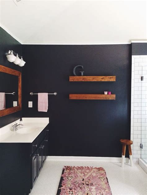 bathroom  dark walls white subway tile wrought iron