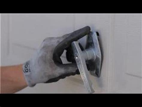 how to change a garage door lock garage door help how to replace a garage door lock or handle