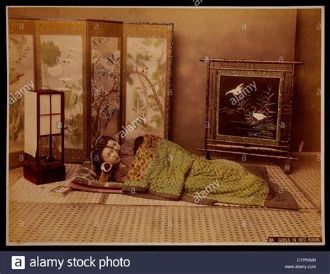 Two Japanese Girls Sleeping In Bedroom, Circa 1880 Stock Photo, Royalty Free Image