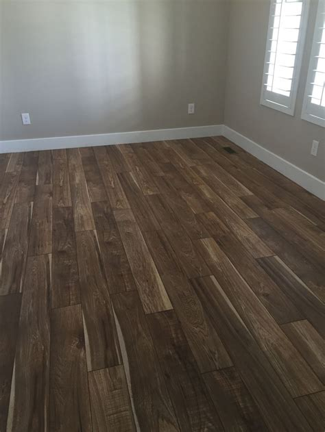 Real hand sawn hickory hardwood flooring? Nope. Just