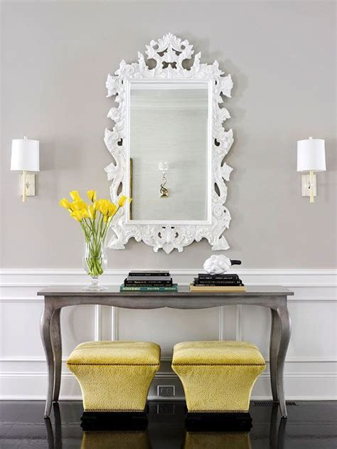 grey entryway table yellow and gray entry transitional entrance foyer bhg