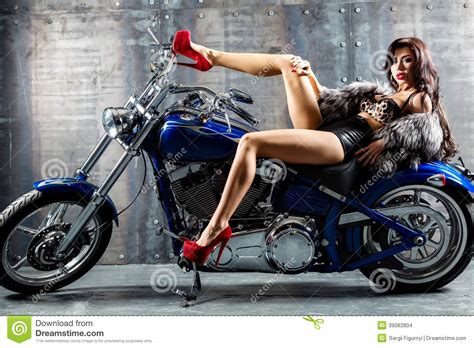 Young Woman Sitting On Motorcycle. Stock Photo