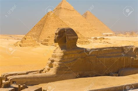 A Side View Of The Great Sphinx With All The Pyramids