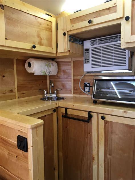Our DIY 6X10 cargo trailer conversion kitchen.   Cargo