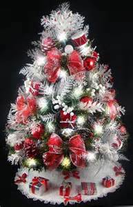 fully decorated mini tabletop christmas tree red and silver