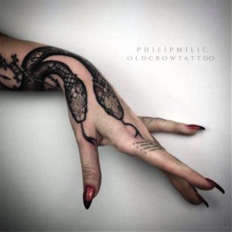 magnifying snake tattoos  wrist
