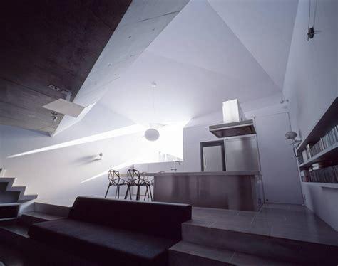 modern concrete house built   budget  featuring  irregular shape