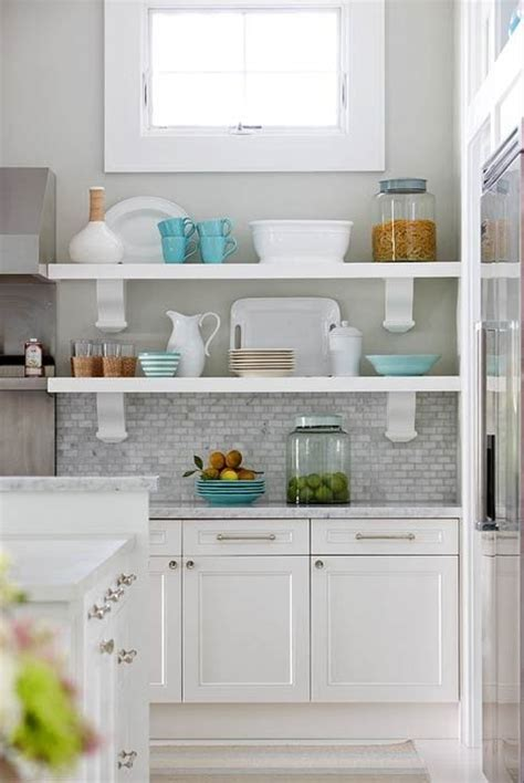 white kitchen cabinets  grey countertops  darker
