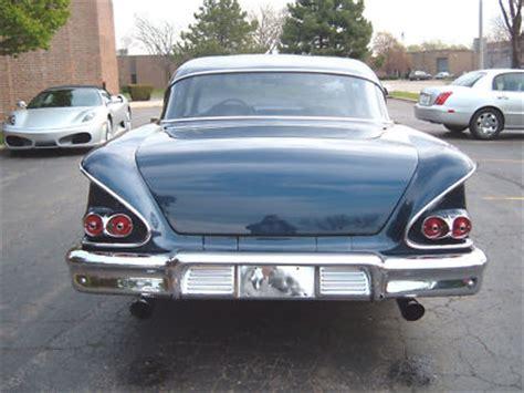blue framed  chevy delray impala  car  fun