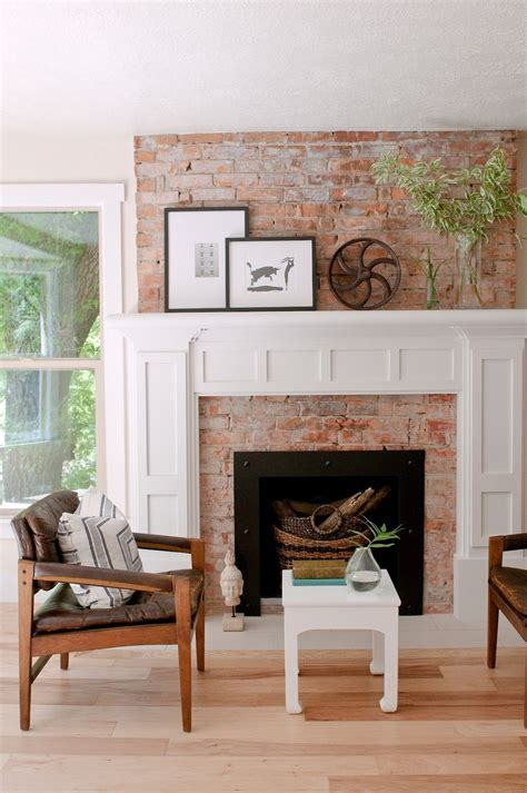exposed brick fireplace  white painted mouldings