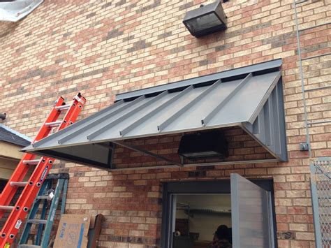 » Standing Seam & Corrugated Metal Awnings