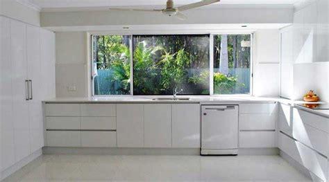 sleek  white handleless kitchen renovation